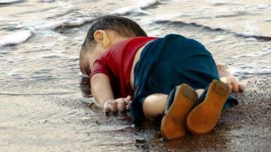 "I cried for 15 minutes when I saw this picture of little Aylan Kurdi in September, just three years old. Photographer Nilufer Demir of the Dogan News Agency said her ""blood froze."""